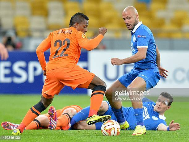 FC Dnipro's Jaba Kankava vies with Brugge's Jose Izquierdo during the UEFA Europa League second leg quarterfinal football match between FC Dnipro...