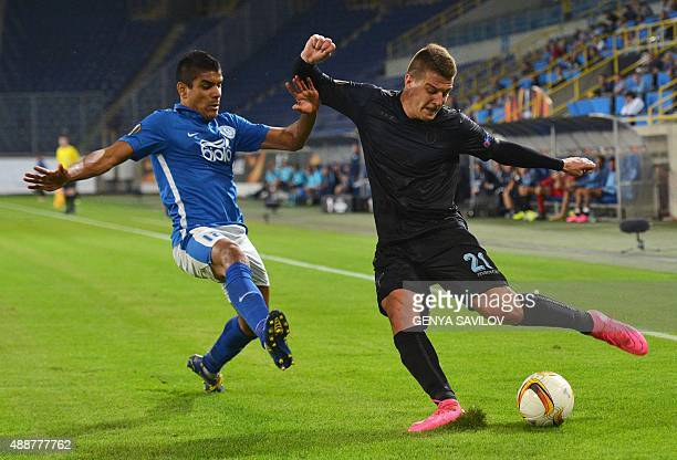 FC Dnipro's Leo Matos vies with Lazio's Sergej MilinkovicSvic during the UEFA Europa League Group G football match between Dnipro Dnipropetrovsk and...