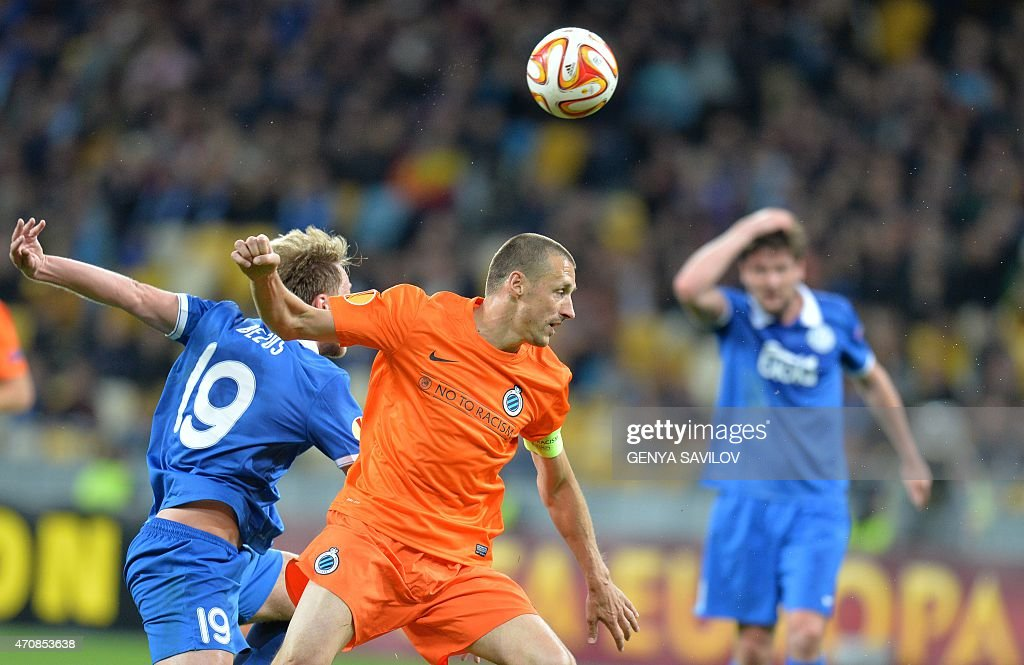FC Dnipro's <a gi-track='captionPersonalityLinkClicked' href=/galleries/search?phrase=Roman+Bezus&family=editorial&specificpeople=8087305 ng-click='$event.stopPropagation()'>Roman Bezus</a> (L) vies for the ball with Brugge's <a gi-track='captionPersonalityLinkClicked' href=/galleries/search?phrase=Timmy+Simons&family=editorial&specificpeople=794114 ng-click='$event.stopPropagation()'>Timmy Simons</a> (R) during the UEFA Europa League second leg quarter-final football match between FC Dnipro Dnipropetrovsk and Club Brugge KV in Kiev on April 23, 2015.