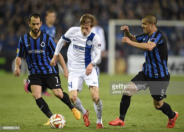 Dnipro's Valeriy Luchkevych vies with Brugge's Victor Vazquez Solsona and Brugge's Andres Francisco Silva during the UEFA Europa League quarterfinal...