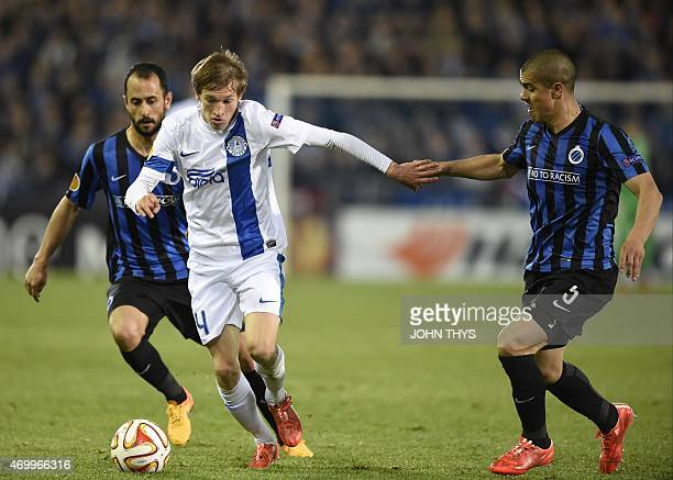 Dnipro's Valeriy Luchkevych vies with Brugge's Victor Vazquez Solsona and Andres Francisco Silva during the UEFA Europa League quarterfinal football...