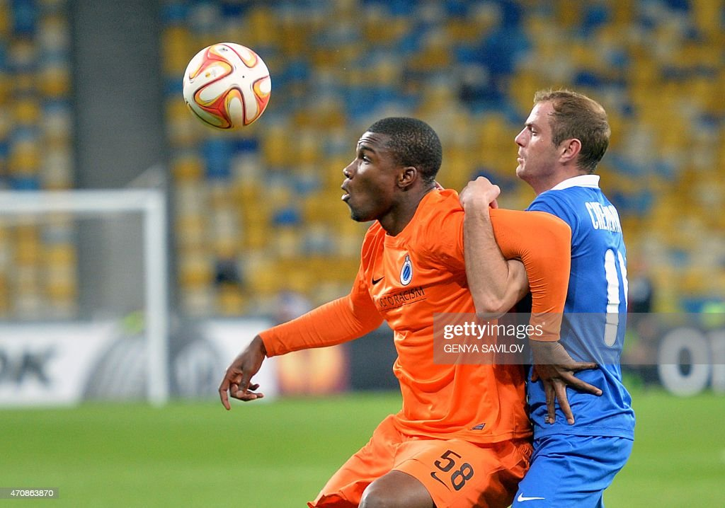 FC Dnipro's <a gi-track='captionPersonalityLinkClicked' href=/galleries/search?phrase=Yevhen+Cheberyachko&family=editorial&specificpeople=8042109 ng-click='$event.stopPropagation()'>Yevhen Cheberyachko</a> (R) vies with Brugge's Obbi Oulare (L) during the UEFA Europa League second leg quarter-final football match between FC Dnipro Dnipropetrovsk and Club Brugge KV in Kiev on April 23, 2015.
