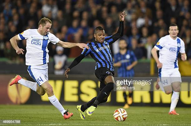 Dnipro's Yevhen Cheberyachko vies with Club's Jose Izquierdo during the UEFA Europa League quarterfinal football match between Club Brugge and...