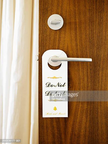 'Do Not Disturb' sign on door handle