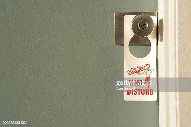 Do Not Disturb sign on doorknob, close-up