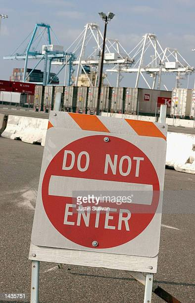 A 'do not enter' sign blocks the entrance of a dock at the Port of Oakland September 25 2002 in Oakland California West Coast longshoremen have been...