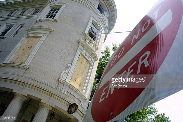 A 'Do Not Enter' sign stands in front of the Estonian embassy July 4 2001 in Washington DC A threealarm fire that caused $25 million USD in damage to...