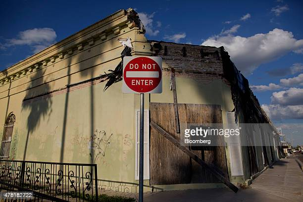 A 'Do Not Enter' signs stands in front of a dilapidated building in Rio Grande City Texas US on Wednesday June 10 2015 The state has authorized $800...