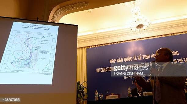 Do Van Hau chairman of the national oil company PetroVietnam uses a powerpoint to show on a map the area where a Chinese oil rig is being installed...