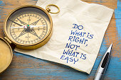 Do what is right, not what is easy  advice or reminder - handwriting on a napkin with an antique brass compass