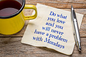 Do what you love and you will never have a problem with Mondays - handwriting on napkin with a cup of tea