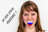 Do you speak Russian? Woman with flag on the tongue - isolated on white background
