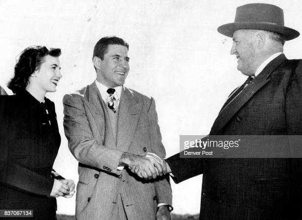 Doak Walker threetime allAmerica backfield star and his bride of less than a week Norma 'dropped' into Denver early Wednesday morning on their way to...