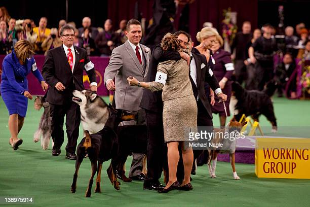 Doberman Pinscher Grand Champion Protocal's Veni Vidi Vici's handler is congratulated by other handlers after they win the Working Group in the...