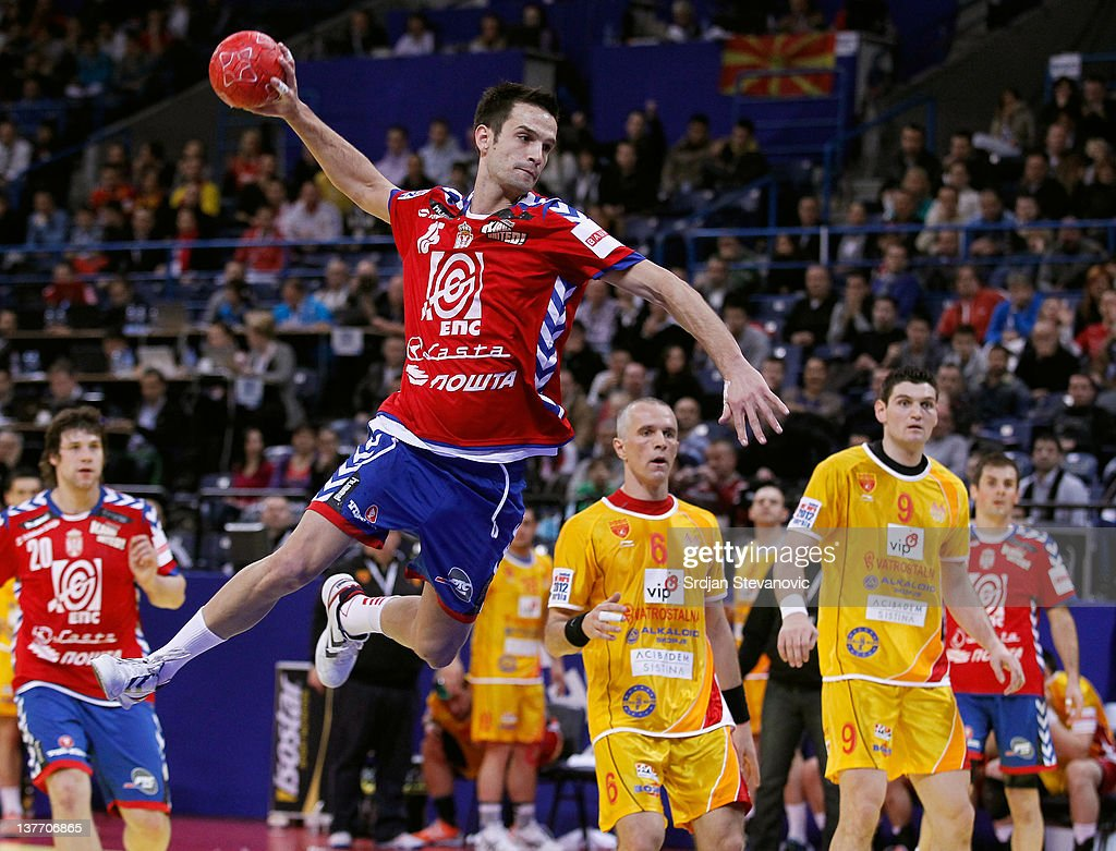 Dobrivoje Markovic (L) of Serbia jumps to score past Stevche Alushovski (C) and Ace Jonovski (R) of Macedonia during the Men's European Handball Championship 2012 second round group one match between Serbia and Macedonia at Arena Hall on January 25, 2012 in Belgrade, Serbia.