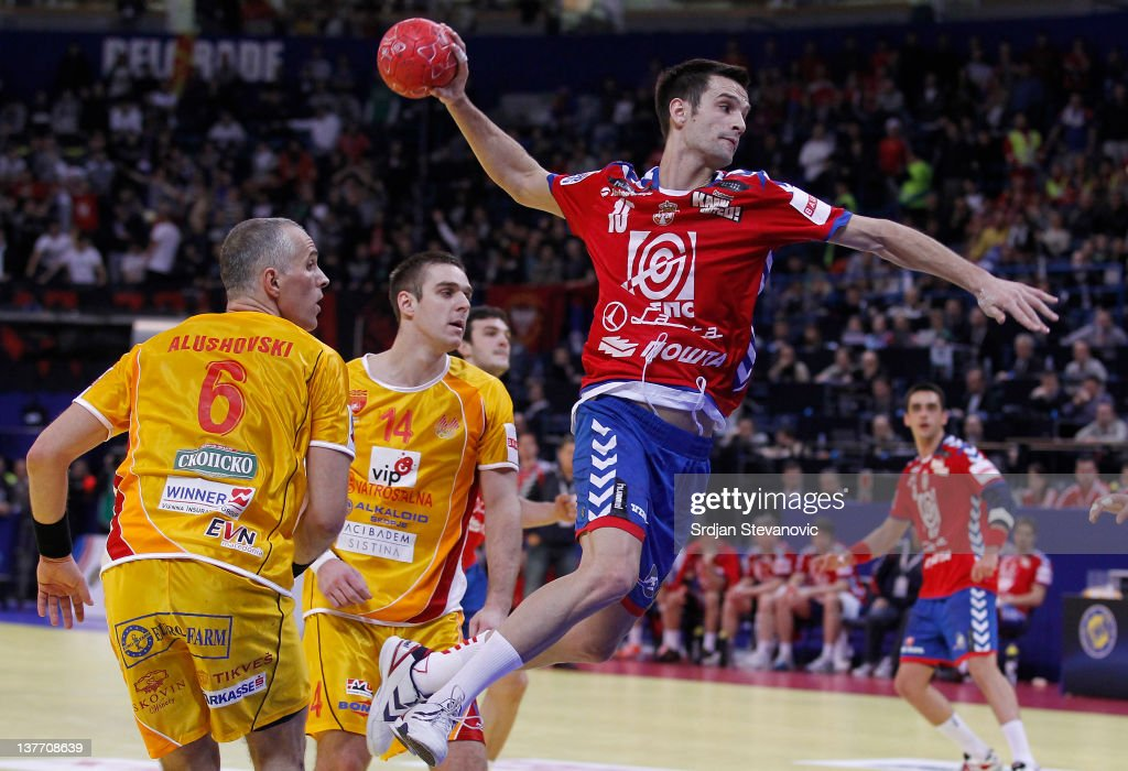 Dobrivoje Markovic (R) of Serbia jumps to score past Velko Markoski (C) and Stevche Alushovski of Macedonia during the Men's European Handball Championship 2012 second round group one, match between Serbia v Macedonia at Arena Hall on January 25, 2012 in Belgrade, Serbia.