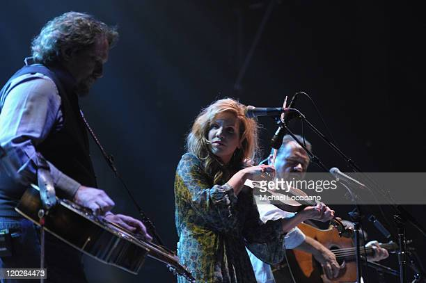 Dobro player Jerry Douglas vocalist and fiddler Alison Krauss and guitarist and vocalist Dan Tyminski perform at the Beacon Theatre on August 2 2011...