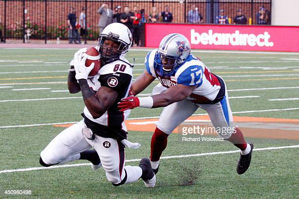 Dobson Collins of the Ottawa Redblacks catches a pass in front of Billy Parker of the Montreal Alouettes during the CFL game at Percival Molson...