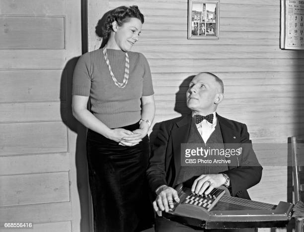 P 'Doc' Davis director and performer with The Bog Trotters mountain music band is photographed seated at an auto harp next to his wife for the CBS...