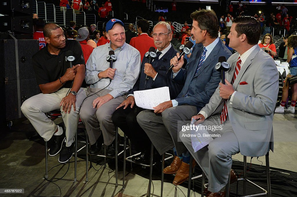 Doc Rivers and Steve Ballmer participate in a Fox Sports West broadcast after the Los Angeles Clippers Fan Festival at STAPLES Center on August 18, 2014 in Los Angeles, California.