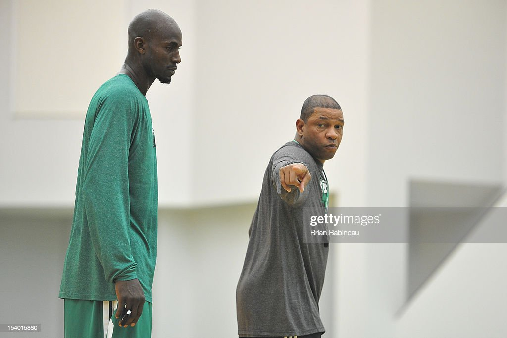 Doc Rivers coaches Kevin Garnett of the Boston Celtics during practice on October 12, 2012 at the Training Center at Healthpoint in Waltham, Massachusetts.