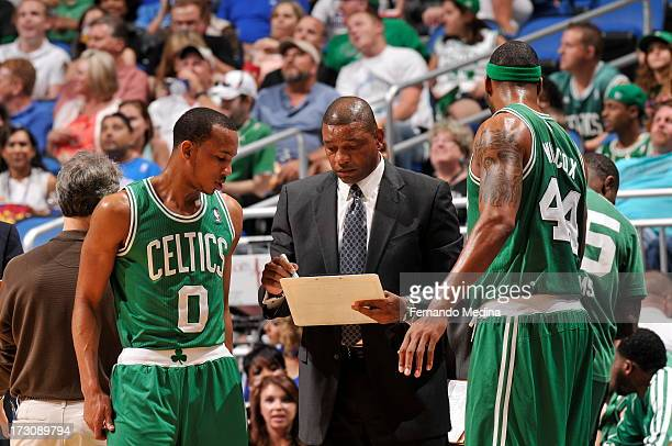 Doc Rivers Head Coach of the Boston Celtics talks with Avery Bradley and Chris Wilcox of the Boston Celtics on April 13 2013 at Amway Center in...