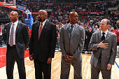 Doc Rivers Mike Woodson Sam Cassell and Lawrence Frank of the Los Angeles Clippers stand on the court before the game against the Denver Nuggets at...