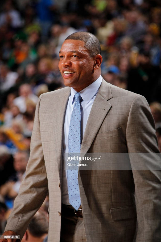 Doc Rivers of the Boston Celtics smiles during the game against the Dallas Mavericks on March 22, 2013 at the American Airlines Center in Dallas, Texas.