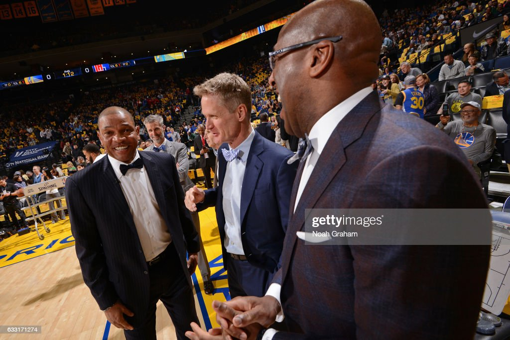Doc Rivers of the LA Clippers talks with Steve Kerr of the Golden State Warriors before the game on January 28, 2017 at oracle Arena in Oakland, California.