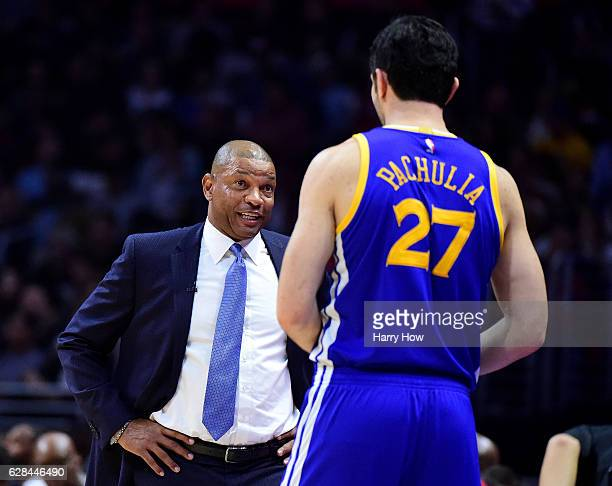 Doc Rivers of the LA Clippers talks with Zaza Pachulia of the Golden State Warriors during a 11598 Warriors win at Staples Center on December 7 2016...