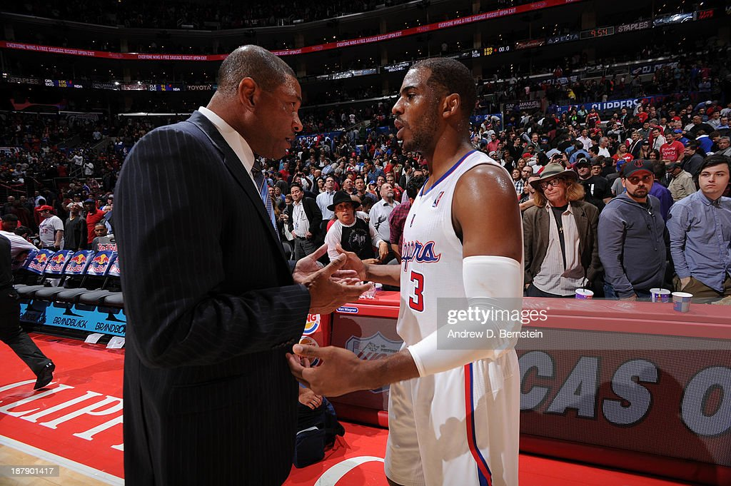 <a gi-track='captionPersonalityLinkClicked' href=/galleries/search?phrase=Doc+Rivers&family=editorial&specificpeople=206225 ng-click='$event.stopPropagation()'>Doc Rivers</a> of the Los Angeles Clippers and <a gi-track='captionPersonalityLinkClicked' href=/galleries/search?phrase=Chris+Paul&family=editorial&specificpeople=212762 ng-click='$event.stopPropagation()'>Chris Paul</a> #3 discuss a play during their game against the Minnesota Timberwolves at Staples Center on November 11, 2013 in Los Angeles, California.