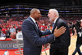 Doc Rivers of the Los Angeles Clippers and Gregg Popovich of the San Antonio Spurs speak before a game in Game One of the Western Conference...