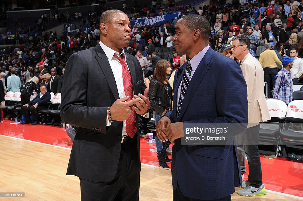 Doc Rivers of the Los Angeles Clippers and Isiah Thomas converse after a game between the Los Angeles Clippers and the Detroit Pistons at STAPLES Center on March 22, 2014 in Los Angeles, California.