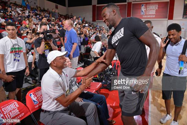 Doc Rivers of the Los Angeles Clippers and Paul Millsap of the Denver Nuggets are seen at the game between the Los Angeles Clippers and the Milwaukee...