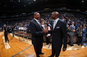 Doc Rivers of the Los Angeles Clippers greets Minnesota Timberwolves assistant coach Terry Porter before the game on March 31 2014 at Target Center...