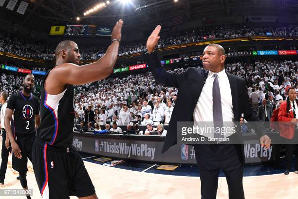 Doc Rivers of the Los Angeles Clippers high fives Chris Paul of the Los Angeles Clippers after the game against the Utah Jazz during the Western...