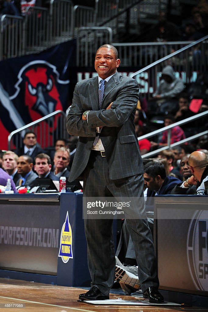 <a gi-track='captionPersonalityLinkClicked' href=/galleries/search?phrase=Doc+Rivers&family=editorial&specificpeople=206225 ng-click='$event.stopPropagation()'>Doc Rivers</a> of the Los Angeles Clippers smiles during the game against the Atlanta Hawks on December 4, 2013 at Philips Arena in Atlanta, Georgia.
