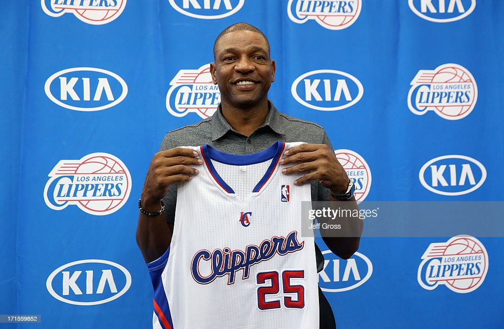 Doc Rivers poses for a portrait after being introduced as the new head coach and senior vice president of basketball operations of the Los Angeles...