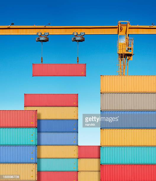 Dock crane lifting cargo container