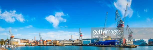 Dock cranes ferries icebreakers working harbour panorama Helsinki Finland