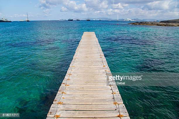 Dock with crystal water in the Formentera island.
