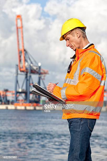 Dock worker with clipboard