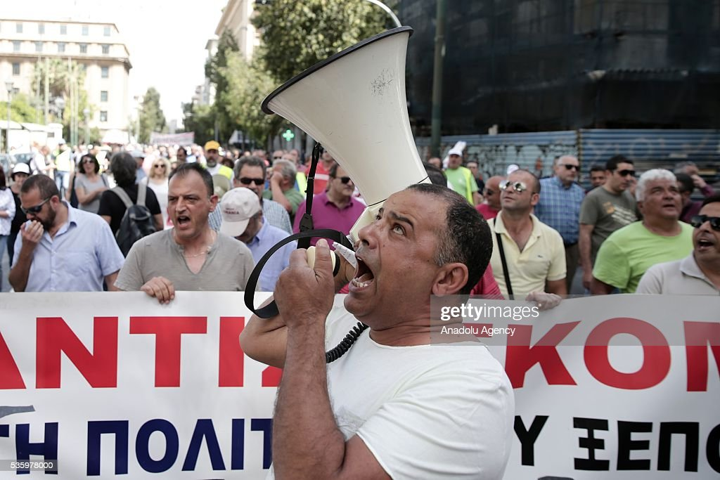 Dock workers attend a protest against the planned privatization of the port Piraeus at Syntagma Square in Athens, Greece on May 31, 2016.