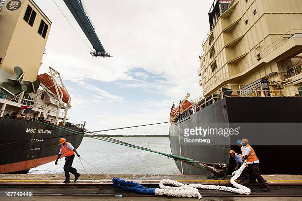 Dock workers for the Kenya Ports Authority a staterun company prepare to secure the Tiger container ship right to the quay side at Mombasa port in...