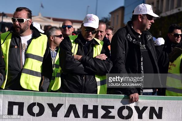 Dock workers participate in a rally in central Athens on December 21 2015 against the sale of Greece's main port in Piraeus Port workers had called...