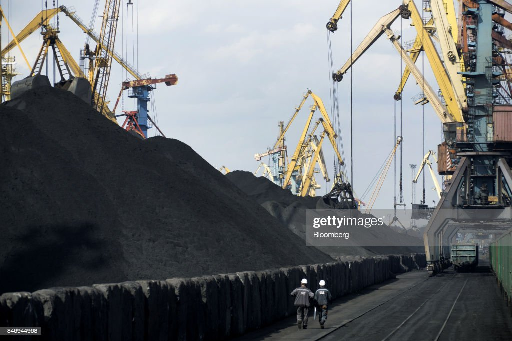 Dock workers pass stores of the first shipment of anthracite coal from U.S. supplier XCoal Energy & Resources LLC, for state energy firm Centrenergo PJSC, during unloading operations on the dockside at Yuzhny Port, near Odessa, Ukraine, on Wednesday, Sept. 13, 2017. A Pennsylvania company will send 700,000 tons of coal to Ukraine in a deal the administration of President Donald Trump heralded as an important tool to undercut the power Russia has over its European neighbors. Photographer: Vincent Mundy/Bloomberg via Getty Images