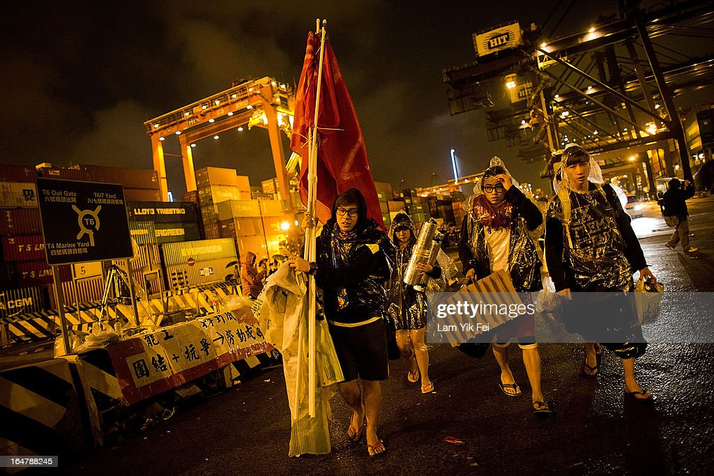 Dock workers stage a sit-in as they go on strike over pay at the Kwai Chung Container Terminal on March 28, 2013 in Hong Kong, China. The workers, who are employed by the Hongkong International Terminals, are demanding higher wages, claiming that they have not received a pay rise for 15 years.