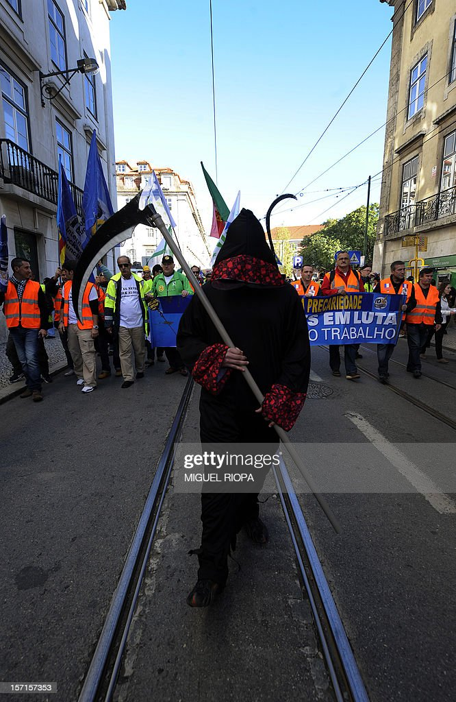 A docker dressed as the Death takes part in a demonstration on November 29, 2012 in Lisbon. Dockers of Lisbon harbour have been on strike for two months in protest against the reform of their working arrangements currently under discussion by the government.