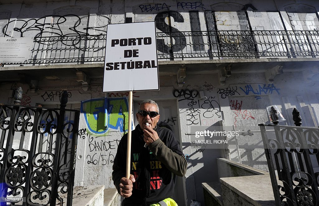 A docker takes part in a demonstration on November 29, 2012 in Lisbon. Dockers of Lisbon harbour have been on strike for two months in protest against the reform of their working arrangements currently under discussion by the government.