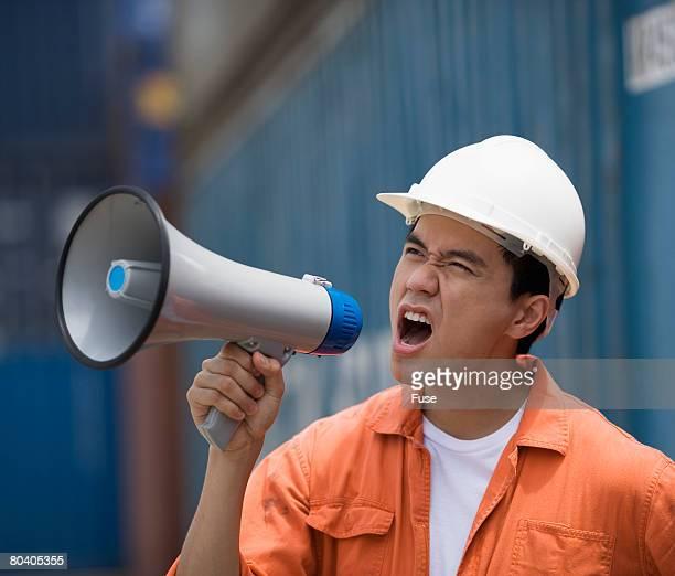 Docker Worker Talking Through Bull Horn